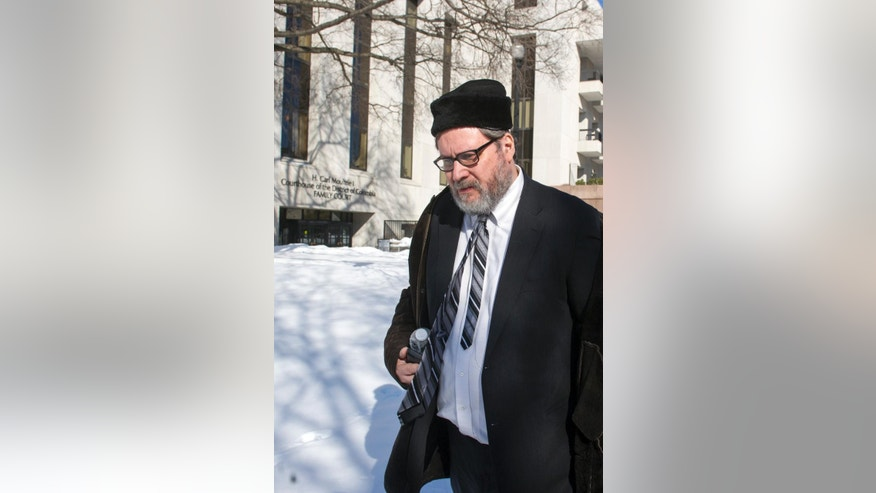 Rabbi Barry Freundel leaves the D.C. Superior Court House in Washington, Thursday, Feb. 19, 2015. Freundel accused of videotaping women at a Jewish ritual bath, was in court for a scheduled status hearing.  (AP Photo/Cliff Owen)
