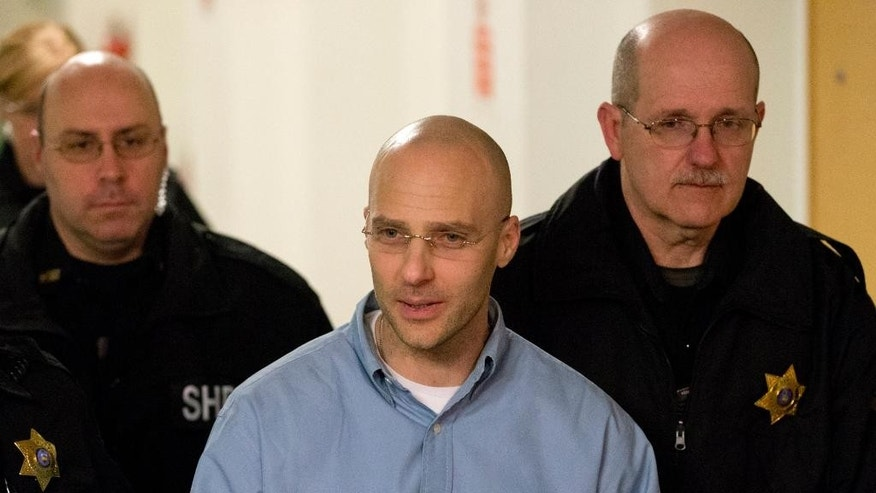 Hugo Selenski, center, is led out of the Luzerne County Courthouse on Wednesday evening, Feb. 18, 2015, in Wilkes-Barre, Pa. A jury on Wednesday spared the life of Selenski, convicted of strangling pharmacist Michael Kerkowski and his girlfriend, Tammy Fassett, during a robbery at the pharmacist's home in 2002 and burying their bodies in his yard. He will serve life without parole. (AP Photo/The Citizens' Voice, Christopher Dolan) MANDATORY CREDIT