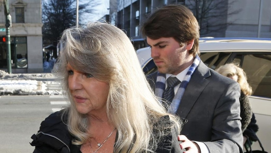 Former first lady Maureen McDonnell, left, arrives at federal court with her son Bobby for her sentencing on corruption charges in Richmond, Va., Friday, Feb. 20, 2015. Federal prosecutors have recommended an 18-month prison term, six months less than former Gov. Bob McDonnell received when he was convicted on 11 counts last month. (AP Photo/Steve Helber)