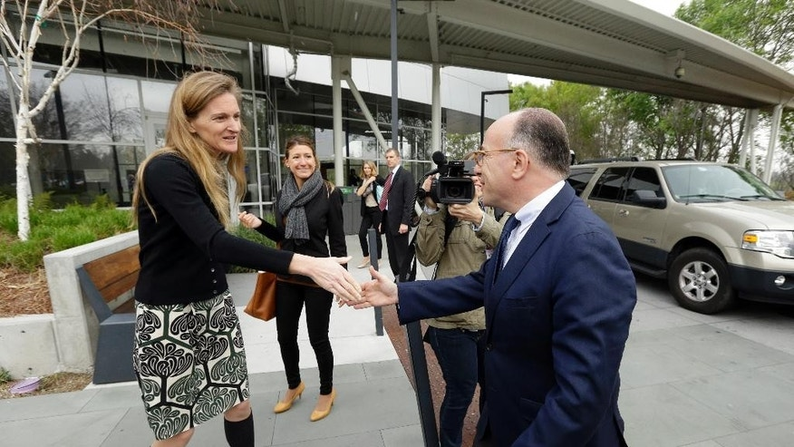 Google Senior Vice President of Communication Rachel Whetstone, left, greets French Interior Minister Bernard Cazeneuve upon his arrival at Google headquarters Friday, Feb. 20, 2015, in Mountain View, Calif. (AP Photo/Ben Margot)