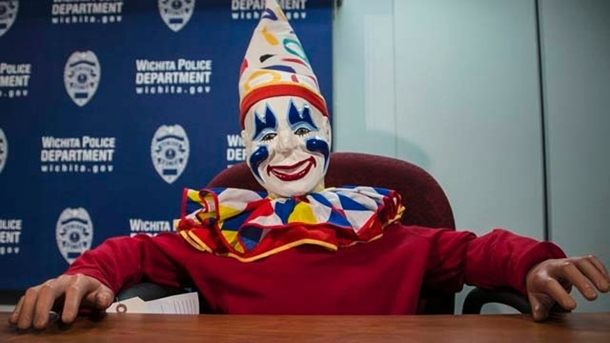 Feb. 19, 2015: Joyland's organ-playing mascot Louie the Clown appears at a daily police briefing in the Wichita City Hall police headquarters in Wichita, Kan. Louie, who disappeared from a closed Wichita amusement park more than a decade ago, was found at the home of a sex offender who used to work at the park. (AP Photo/The Wichita Eagle, Mike Hutmacher)