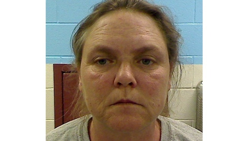 This photo released by the Etowah County Sheriff's Office shows Joyce Hardin Garrard, who is is charged with capital murder, accused of making her 9-year-old granddaughter, Savannah Hardin, run until the girl collapsed and died, all as punishment for lying about candy. (AP/Etowah County Sheriff's Office)