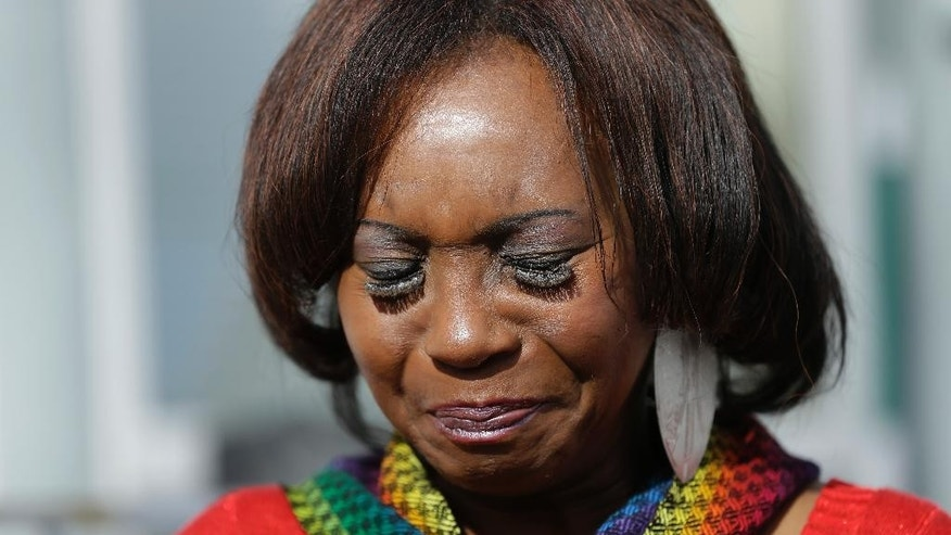 Asale Haquekyah Chandler closes her eyes while remembering her slain son, Yalani Chandler, during an interview Tuesday, Feb. 10, 2015, in San Francisco. In January, four young men sitting in a stolen car were gunned down in a trendy neighborhood near City Hall. Chandler, the mother of one of the quadruple homicide victims, says she's upset that her son's killers haven't been found. (AP Photo/Ben Margot)