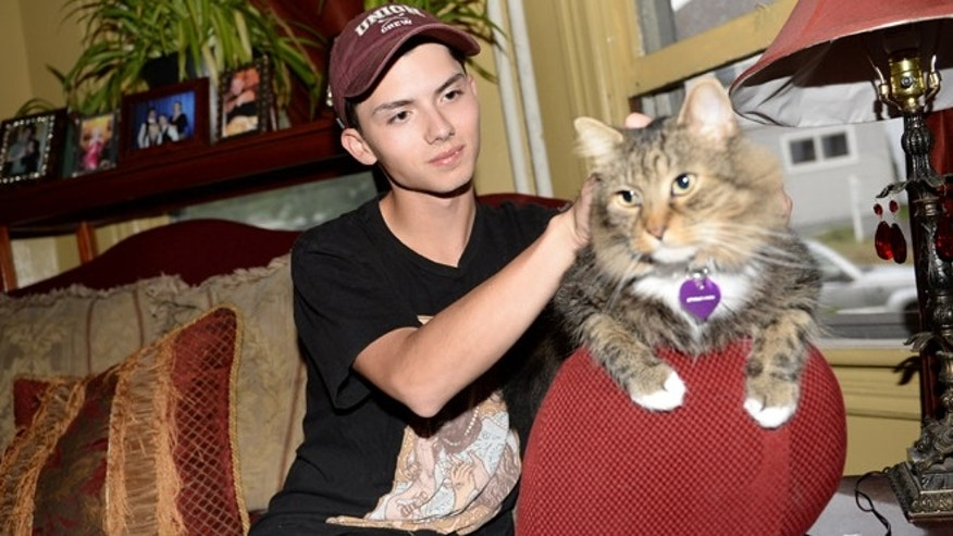 Sept. 10, 2014: In a file photo, Draven Rodriguez and his cat Mr. Bigglesworth at their home in Schenectady, N.Y. (AP/The Daily Gazette, Patrick Dodson)