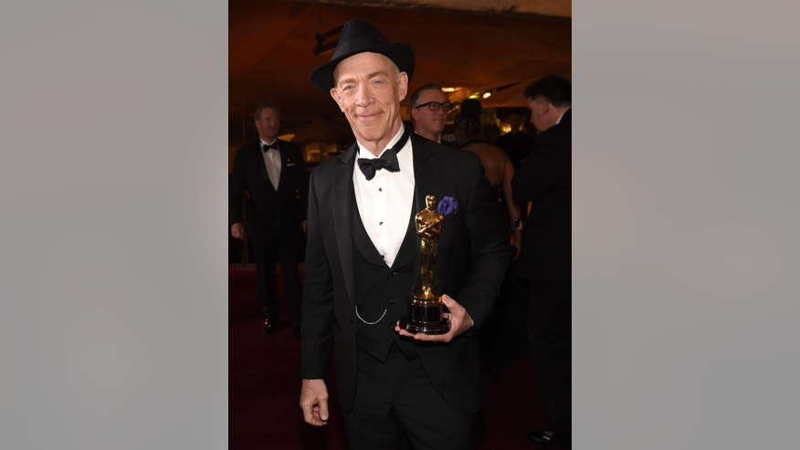 "J.K. Simmons, winner of the award for best actor in a supporting role for ""Whiplash"", attends the Governors Ball after the Oscars on Sunday, Feb. 22, 2015, in Los Angeles. (Photo by Chris Pizzello/Invision/AP)"