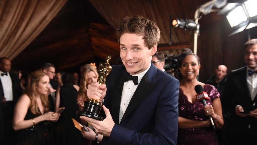 "Eddie Redmayne, winner of the award for best actor in a leading role for ""The Theory of Everything"", attends the Governors Ball after the Oscars on Sunday, Feb. 22, 2015, in Los Angeles. (Photo by Chris Pizzello/Invision/AP)"