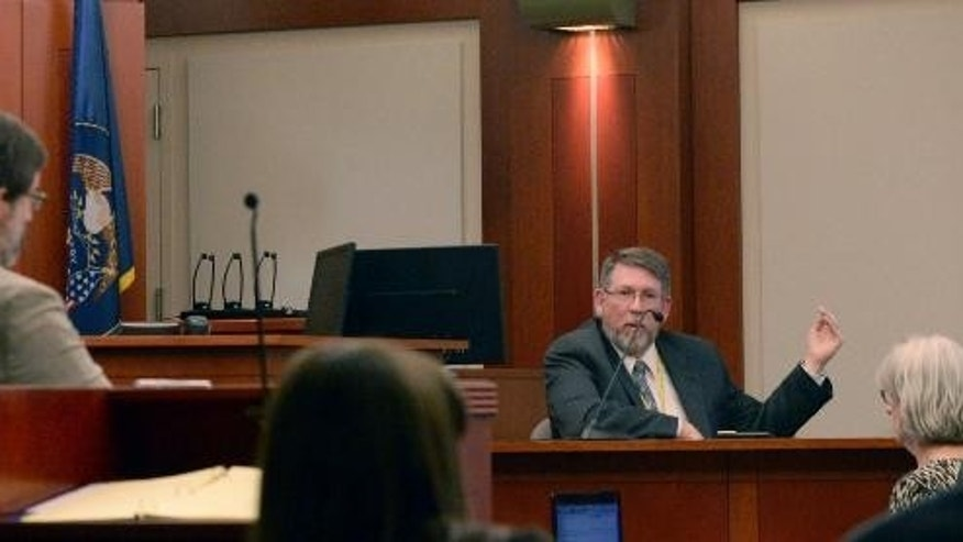 Defense lawyer Fred Metos, left, questions medical examiner Dr. Erik Christensen, right, seated on the stand, during the trial of John Brickman Wall in Salt Lake City on Feb. 23, 2015. Christensen testified that an autopsy showed that von Schwedler had suspicious wounds on her wrist and leg.  Christensen said Monday that the 2011 death of Uta von Schwedler in Salt Lake City initially looked like a suicide, but the wounds pointed to a homicide. (AP Photo/The Salt Lake Tribune, Al Hartmann, Pool)