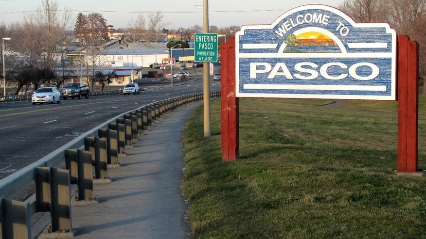 In this Feb. 18, 2015 photo, a sign welcomes motorists to Pasco, Wash. For the past week, protesters have gathered daily in front of the City Hall in this agricultural community to protest the fatal shooting of Antonio Zambrano-Montes, an unarmed man who was running away from police at a crowded intersection. (AP Photo/Nicholas K. Geranios)