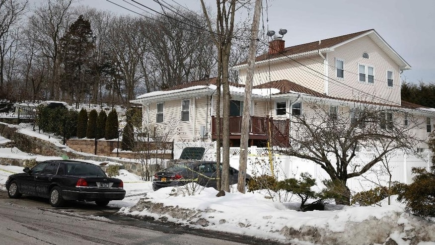 A police car is stationed in front the home of retired White Plains Officer Glen Hochman, the site of an apparent murder-suicide, in Harrison, N.Y on Monday, Feb. 23, 2015. Harrison police Chief Anthony Marraccini says the retired officer's suicide note indicates that the killing of his teenage daughters in their beds was a premeditated act. Marraccini said 17-year-old Alissa and 13-year-old Deanna apparently were asleep when they were shot sometime after 2 a.m. Saturday. (AP Photo/Seth Wenig)