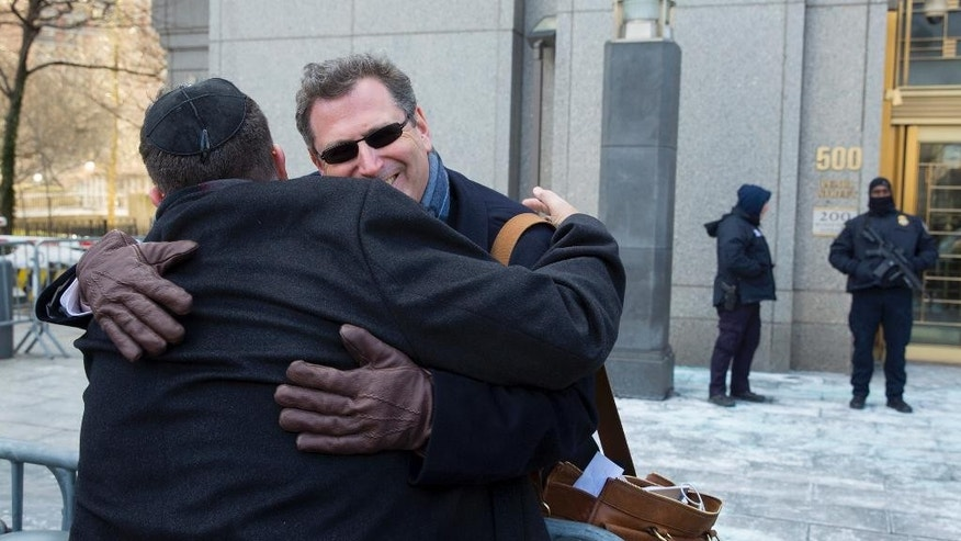 Attorney Kent Yalowitz, right, representing those affected by attacks in Israel in the early 2000s, hugs Mark Weiss of New York outside a federal courthouse in New York Monday, Feb. 23, 2015. The court found the Palestinian authorities liable in the attacks, with jurors awarding the victims $218.5 million in damages at a civil trial.  (AP Photo/Craig Ruttle)