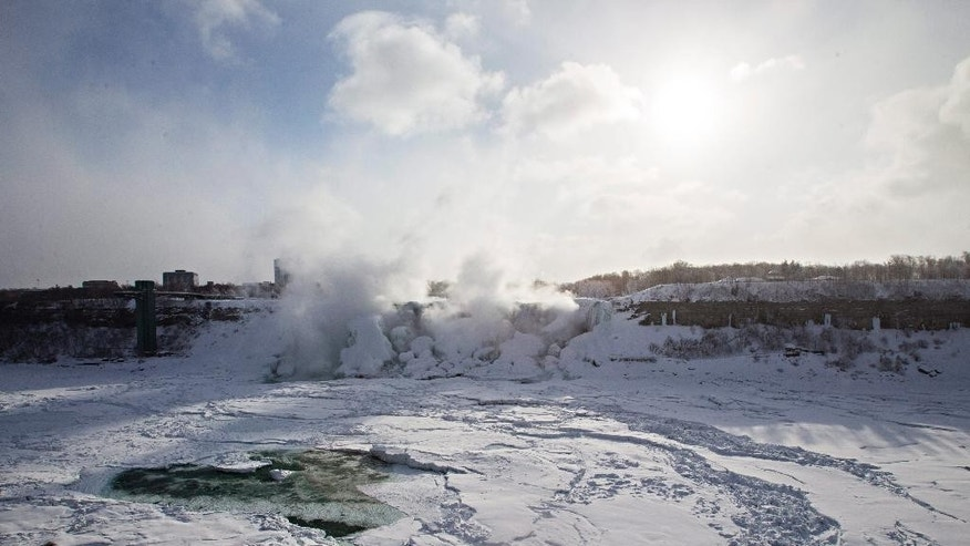 Masses of ice form in the lower Niagara River and around the American Falls as seen from Niagara Falls, Ontario, Canada, Thursday, Feb. 19, 2015. (AP Photo/The Canadian Press,Aaron Lynett)