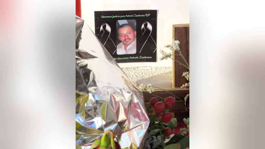 In this Feb. 19, 2015 photo, a photo of Antonio Zambrano-Montes, is displayed at a memorial in Pasco, Wash., at the site where Zambrano-Montes, an unarmed man who was running away from police, fell after being fatally shot by police. Zambrano-Montes was killed Feb. 10, the gunfire captured on video by a witness. (AP Photo/Nicholas K. Geranios)