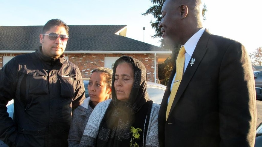 Agapita Montes-Rivera, second from right, the mother of Antonio Zambrano-Montes, who was shot and killed by police in Pasco, Wash., on Feb. 10, 2015, stands Monday, Feb. 23, with her daughter, Rose Elena Zambrano-Montes, second from left, attorney Benjamin Crump, right, and interpreter Fabian Ubay as they talk to the media in Pasco, outside the funeral home where the body of her son was being kept. Crump, who is the attorney who represented the family of Michael Brown, who was shot and killed by a police officer in Ferguson, Mo., said he will be representing Zambrano-Montes' family. (AP Photo/Nicholas K. Geranios)
