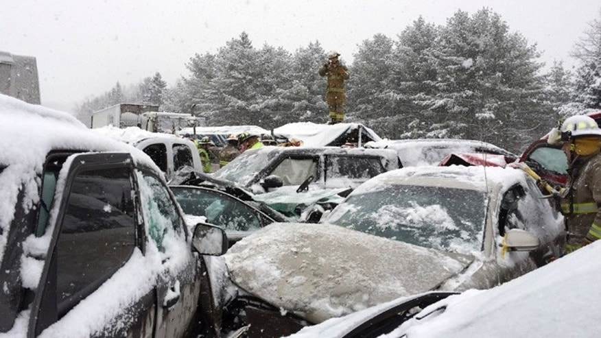 Feb. 25, 2015: In this photo provided by Maine State Police and Maine Emergency Management, emergency personnel respond to a multi-vehicle pileup along Interstate 95 in Etna, Maine.