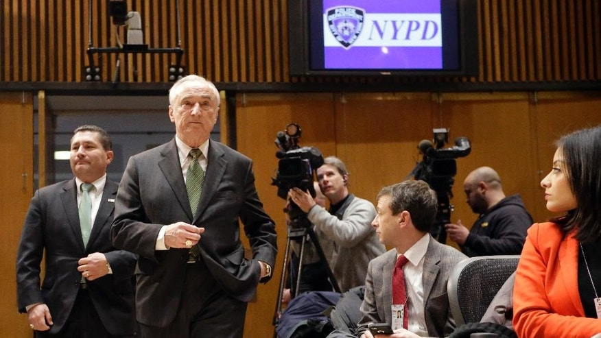 New York Police Commissioner William Bratton, second from left, and Diego Rodriguez, assistant director in charge of the FBI's New York field office, arrive for a news conference at police headquarters, Wednesday, Feb. 25, 2015, in New York, regarding three men who were arrested on charges of plotting to travel to Syria to join the Islamic State group and wage war against the U.S. Akhror Saidakhmetov was arrested at Kennedy Airport, where he was attempting to board a flight to Istanbul, authorities said. Abdurasul Hasanovich Juraboev had a ticket to travel to Istanbul next month and was arrested in Brooklyn, federal prosecutors said. Abror Habibov, 30,  accused of helping fund Saidakhmetov's efforts, was arrested in Florida. (AP Photo/Mary Altaffer)