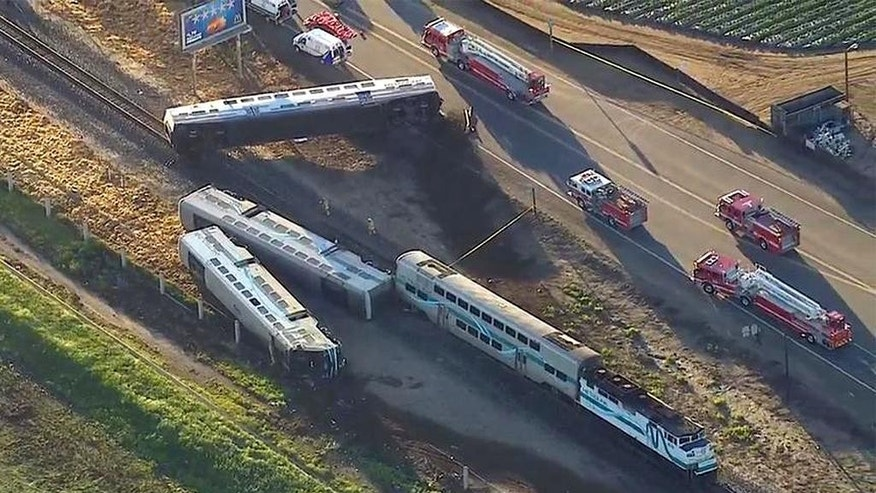 This image from video provided by KABC-TV Los Angeles shows wreckage of a Metrolink commuter train after it crashed into a truck and derailed early on Tuesday, Feb. 24, 2015 in Oxnard, Calif. Three cars of the Southern California Metrolink commuter train derailed and tumbled onto their sides after the collision on tracks in Ventura County, northwest of Los Angeles. (AP Photo/KABC-TV)