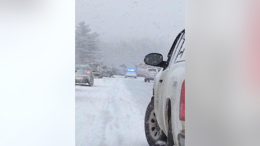 In this photo provided by Maine State Police And Maine Emergency Management, traffic is at a stand still as emergency personnel respond to a multi vehicle pileup on Interstate 95 near Bangor, Maine, Wednesday, Feb. 25, 2015.  State police spokesman Steve McCausland says the pileup in Etna happened early Wednesday in heavy snow and involved many cars, a school bus and a tractor trailer. No fatalities were immediately reported but McCausland says some of the injuries were serious.  (AP Photo/Maine State Police And Maine Emergency Management, Stephen McCausland)