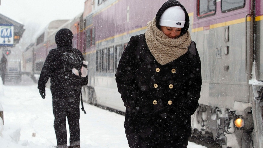 Feb. 9, 2015: Passengers wait at the commuter rail train station.