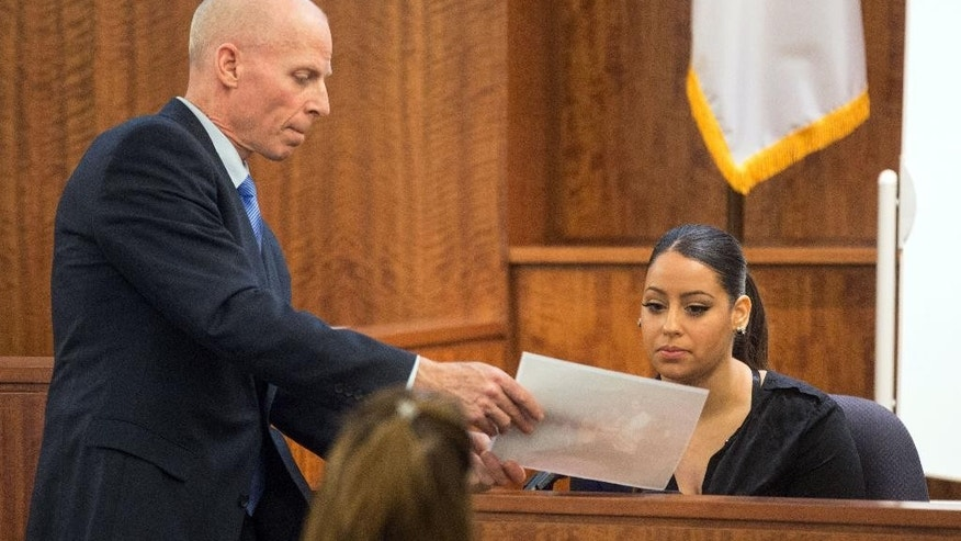 Prosecutor William McCauley, left, questions Vanessa Sanchez, right, during testimony at the murder trial of former New England Patriots football player Aaron Hernandez at Bristol County Superior Court in Fall River, Mass., Wednesday, Feb. 25, 2015. Hernandez is accused of the murder of Odin Lloyd in June 2013.  (AP Photo/Aram Boghosian, Pool)