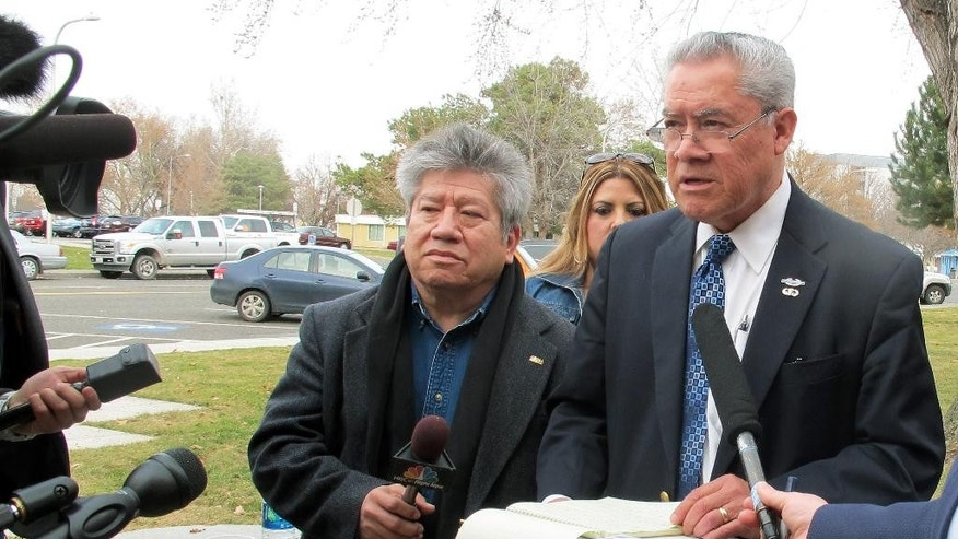 Activist Felix Vargas, right, talks with reporters, Wednesday, Feb. 25, 2015, after a briefing on the investigation of the fatal police shooting of Antonio Zambrano-Montes, who was unarmed, in nearby Pasco, Wash., on Feb. 10, 2015. Vargas said he is calling for a federal investigation of the shooting. (AP Photo/Nicholas K. Geranios)