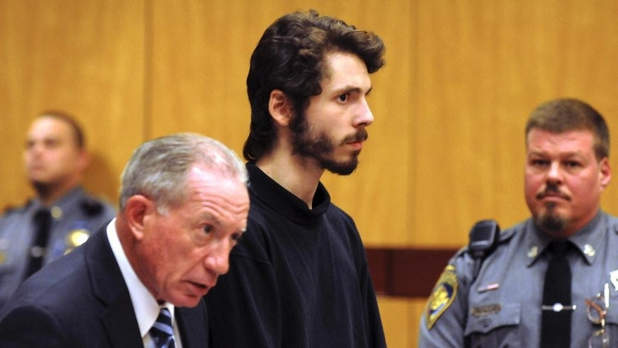 Wesleyan University senior and neuroscience major Eric Lonergan, 22, stands during arraignment at Middletown, Conn., Superior Court on Wednesday, Feb. 25, 2015, for possession of controlled substances and other charges. He is one of four students arrested after a rash of illnesses on campus linked to the party drug Molly. (AP Photo/The Hartford Courant, Patrick Raycraft, Pool)