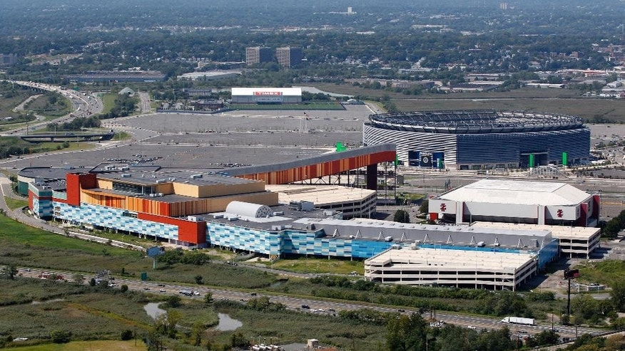 FILE- In this Thursday, Sept. 1, 2011 file photo, MetLife Stadium, rear right, and the Izod Center, middle right, are seen behind American Dream, formerly called Xanadu, the unfinished oddly patterned shopping and entertainment complex in East Rutherford, N.J. Court filings in the upcoming racketeering trial of a former prominent Democratic power broker have offered a glimpse into the machinations behind the long-delayed, multibillion-dollar project _ including once-secret grand jury testimony alleging Sen. Robert Menendez, at the time a member of the House, sought $50,000 in donations from a developer after pushing for a needed permit. (AP Photo/Mel Evans, file)