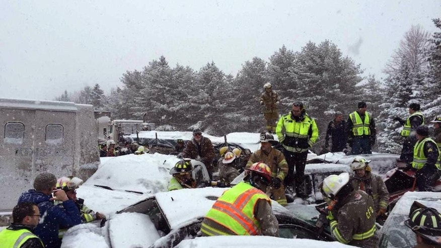 In this photo provided by Maine State Police And Maine Emergency Management, emergency personnel respond to a multi vehicle pileup on Interstate 95 near Bangor, Maine, Wednesday, Feb. 25, 2015.  State police spokesman Steve McCausland says the pileup in Etna happened early Wednesday in heavy snow and involved many cars, a school bus and a tractor trailer. No fatalities were immediately reported but McCausland says some of the injuries were serious.  (AP Photo/Maine State Police And Maine Emergency Management, Stephen McCausland)
