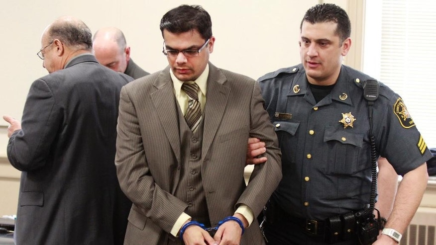 A Morris County Sheriff's Officer escorts Kashif Parvaiz out of court after a jury found him guilty on Thursday, Feb. 26, 2015 in Morristown, N.J.  A jury deliberated for less than four hours before convicting Parvaiz of scheming with his girlfriend to kill his wife  27-year-old Nazish Noorani and make it look like a random attack.  Antoinette Stephen pleaded guilty to murder and other offenses and testified against Parvaiz.  He faces life in prison at his sentencing, which is scheduled for April 24.(AP Photo/The Star-Ledger, Robert Sciarrino, Pool)