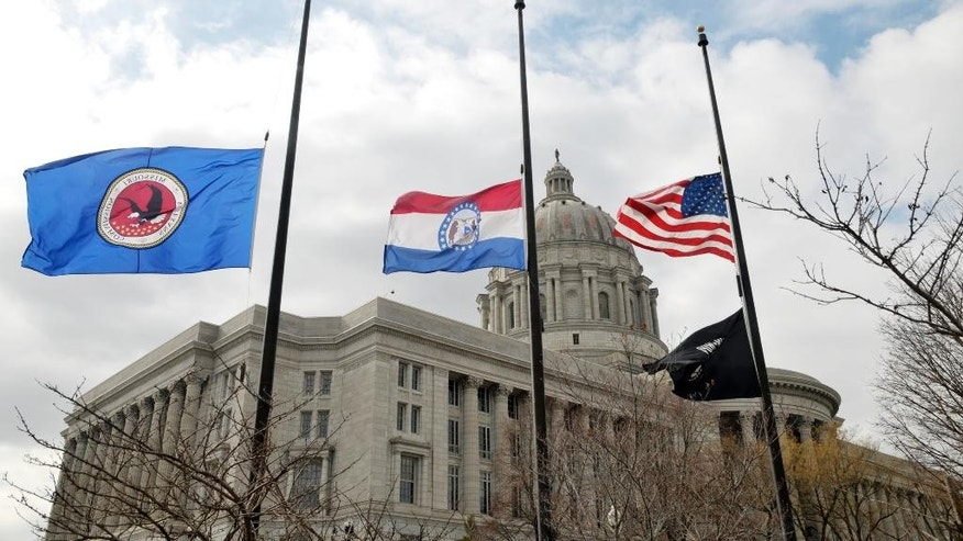 "Flags around the Missouri Capitol complex in Jefferson City were lowered to half staff Thursday, Feb. 26, 2015, after the death of State Auditor Tom Schweich, who died Thursday morning. Police in suburban St. Louis are calling the death of Schweich an ""apparent suicide."" (AP Photo/The Jefferson City News-Tribune, Julie Smith)"