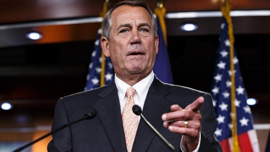 "House Speaker John Boehner of Ohio responds to reporters about the problems in passing the Homeland Security budget because of Republican efforts to block President Barack Obama's executive actions on immigration, Thursday, Feb. 26, 2015, during a news conference on Capitol Hill in Washington. The House voted last month to end Homeland Security funding on Saturday unless Obama reverses his order to protect millions of immigrants from possible deportation. After Democratic filibusters blocked the bill in the Senate, the chamber's Republican leaders agreed this week to offer a ""clean"" funding measure, with no immigration strings attached.  (AP Photo/J. Scott Applewhite)"