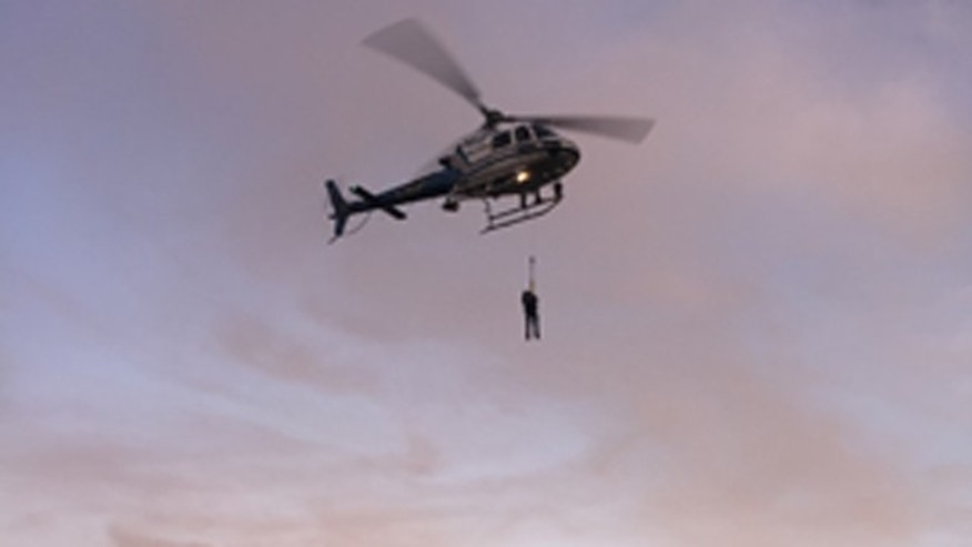 Feb. 26, 2015: In this photo provided by the National Park Service a California Highway Patrol helicopter lifts a suspect to safety during the rescue of two suspected vandals at Golden Gate National Recreation Area. Park service spokeswoman Alexandra Picavet says the men got stuck on a cliff at the waterfront of Fort Baker in Golden Gate National Recreation Area. (AP Photo/U.S. National Park Service)
