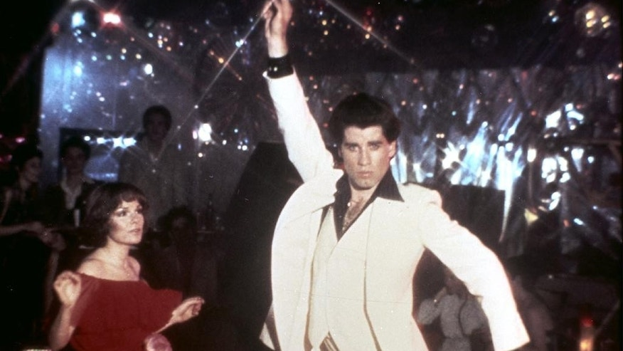 "FILE - In this 1977 file photo originally released by Paramount Pictures, John Travolta and Karen Lynn Gorney are shown in a scene from, ""Saturday Night Fever.""  Since strutting onto the big screen in ""Saturday Night Fever,"" John Travolta's career has been one of dramatic ups and downs, from comeback king to Internet meme. Travolta, 61, is prepping a handful of projects and ahead of the release of an explosive documentary on Scientology that focuses considerably on Travolta's relationship with the organization.   (AP Photo/Paramount Pictures, File)"