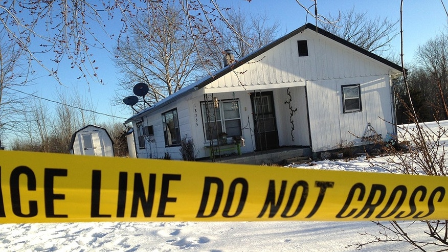Police tape surrounds one of the crime scenes in Tyrone, Mo., Friday, Feb. 27, 2015. Authorities say multiple people were shot to death and one was wounded in attacks in the small southeastern Missouri town, and the suspected gunman was found dead from an apparent self-inflicted gunshot wound. (AP Photo/Houston Herald, Jeff McNiell)
