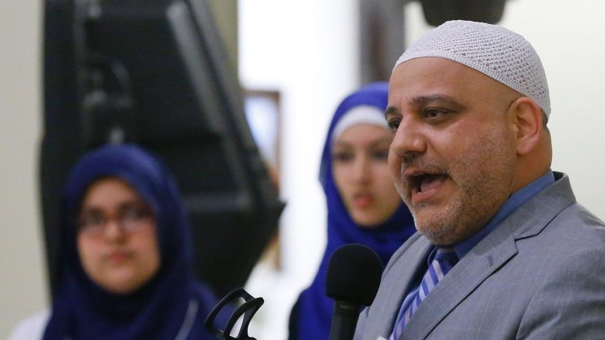 Imam Imad Enchassi, president of the Islamic Society of Greater Oklahoma City, addresses a group inside the state Capitol during Muslim Day at the Capitol, Friday, Feb. 27, 2015,  in Oklahoma City. Friday's event is designed to foster civic participation by Oklahoma Muslims. (AP Photo/Sue Ogrocki)
