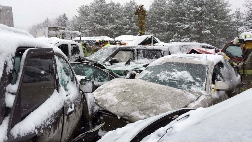Feb. 25, 2015: Emergency personnel respond to a multi-vehicle pileup along Interstate 95 in Etna, Maine.