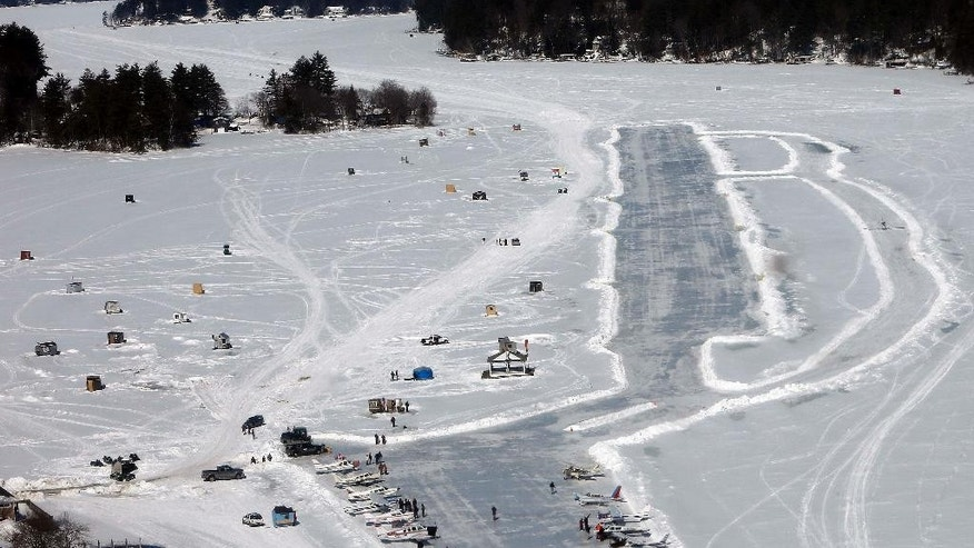 Planes are parked after flying in on frozen Lake Winnipesaukee Saturday, Feb. 28, 2015, in Alton,N.H. Dozens of pilots flew in to the the only ice runway in the Lower 48 states approved by the Federal Aviation Administration.  (AP Photo/Jim Cole)