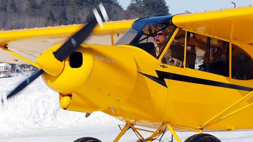 Angela Leedy of Pittstown, N.J., looks for a parking spot after flying three hours to the only ice runway in the Lower 48 states approved by the Federal Aviation Administration Saturday, Feb. 28, 2015, on Lake Winnipesaukee in Alton,N.H.   The 3,000-foot airstrip is popular with pilots, said Airport Director Paul LaRochelle, who keeps it plowed when the ice is strong enough. (AP Photo/Jim Cole)