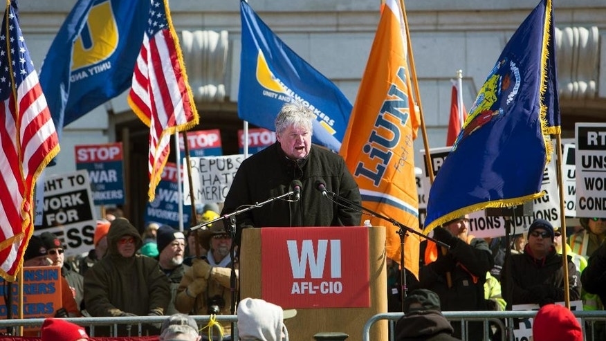 "Wisconsin AFL-CIO president Phil Neuenfeldt speaks during a rally against a ""right-to-work proposal, on Saturday, Feb. 28, 2015, in Madison, Wis. Thousands of Wisconsin union workers rallied at the Capitol Saturday to protest a ""right-to-work"" proposal that would outlaw the mandatory payment of union dues, but the crowd was much smaller than those in 2011 against Gov. Scott Walker's law stripping public sector unions of much of their power.   (AP Photo/Wisconsin State Journal, Steve Apps)"