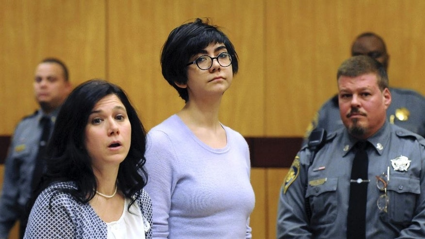 FILE - In this Feb. 25, 2015 file photo, Wesleyan University sophomore Rama Agha Al Nakib, 20,  stands during her arraignment at Middletown, Conn., Superior Court for possession of controlled substances and other charges. She is one of four students arrested after a rash of illnesses on campus linked to the party drug Molly. (AP Photo/The Hartford Courant, Patrick Raycraft, Pool)