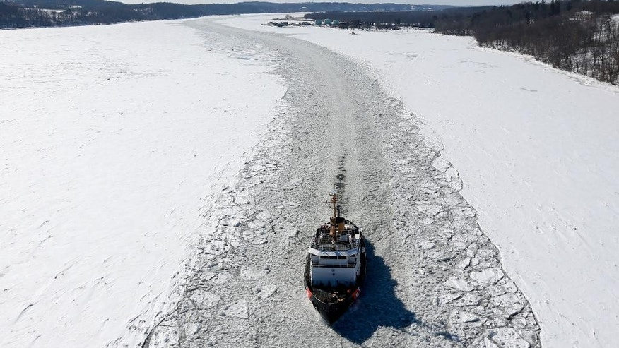 FILE - In this Feb. 27, 2015, file photo, the U.S. Coast Guard cutter Sturgeon Bay breaks ice in the shipping channel on the Hudson River in Catskill, N.Y. With the prolonged cold winter weather, the Coast Guard has been busy clearing shipping lanes. For many cities in the Northeast, it was the coldest February on record, and some places recorded the most days of zero or below temperatures. (AP Photo/Mike Groll, File)