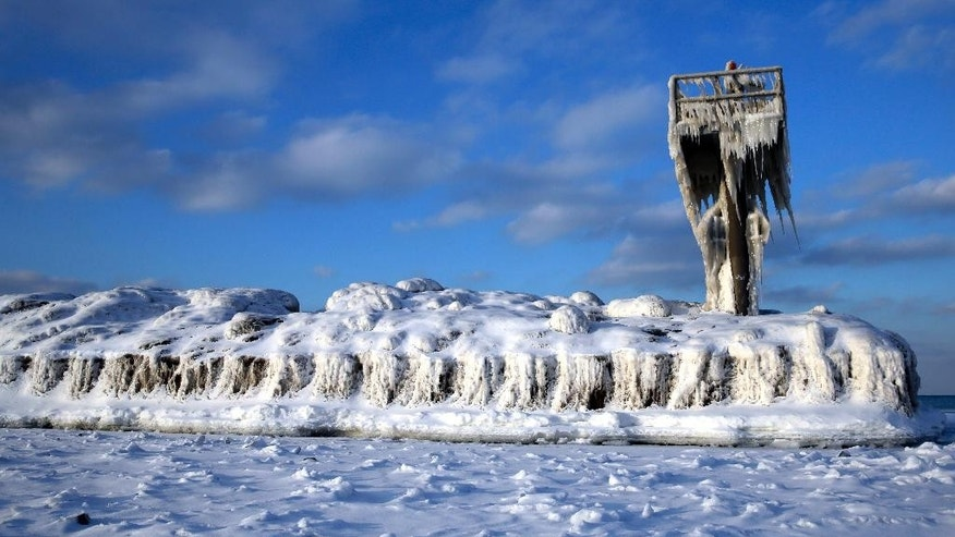 A harbor light is covered by snow and ice on the Lake Michigan at 31st Street Harbor, Sunday, March 1, 2015, in Chicago. After one of the coldest, snowiest February's on record, March is expected to open with a continuation of below-normal temperatures. (AP Photo/Nam Y. Huh)