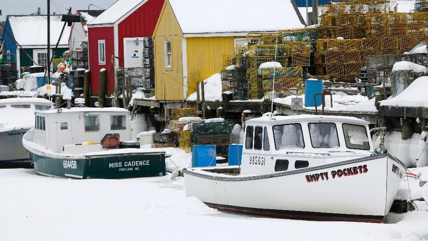 In this Thursday, Feb. 26, 2015 photo, lobster fishing boats are locked in ice at Widgery Wharf in Portland, Maine. Portland Harbor is encountering more ice than it has in years thanks to the coldest February on record. (AP Photo/Robert F. Bukaty)