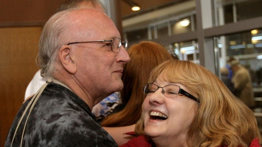 Freed aid worker Russ Petty embraces his wife, Helen, at Hector International Airport, Tuesday, March 3, 2015 in Fargo, N.D. Petty was among four American missionaries who were released after several days of detention and questioning by Venezuelan authorities. (AP Photo/Bruce Crummy)