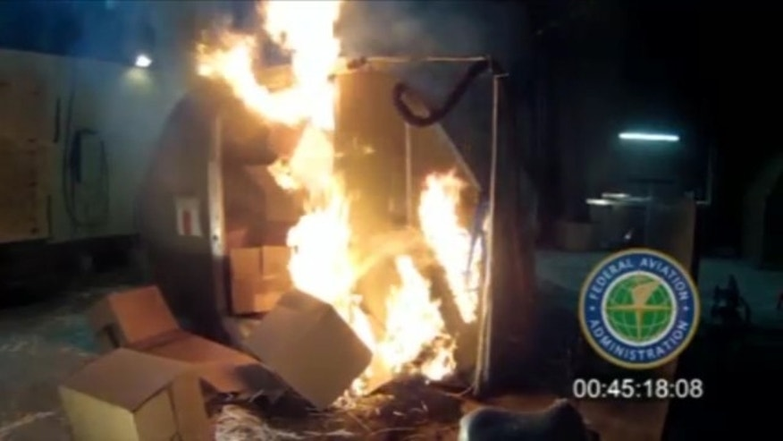 File-This file frame grab from video, provided by the Federal Aviation Administration (FAA) shows a test at the FAAs technical center in Atlantic City, N.J. last April, where a cargo container was packed with 5,000 rechargeable lithium-ion batteries. (AP Photo/FAA, File)