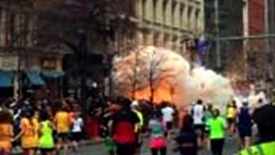 FILE - In this Monday, April 15, 2013, file image from video provided by WBZ-TV, spectators and runners run from an explosion near the finish line of the Boston Marathon. Opening statements are scheduled Wednesday, March 4, 2015, in the federal death penalty trial of Dzhokhar Tsarnaev for allegedly conspiring with his brother to place twin bombs near the finish line of the race, killing three and injuring 260 people. (AP Photo/WBZ-TV, File) MANDATORY CREDIT