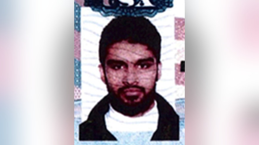 FILE - This undated passport photo provided by the U.S. Attorney's Office in Chicago shows Mohammed Hamzah Khan. A status hearing is scheduled Tuesday, March 3, 2015, in Chicago for Khan, who is facing federal charges of trying to travel with his siblings to Syria to join the Islamic State group. FBI agents raided his family home in Bolingbrook, Ill., for a second time days before the scheduled hearing. (AP Photo/U.S. Attorney's Office, File)
