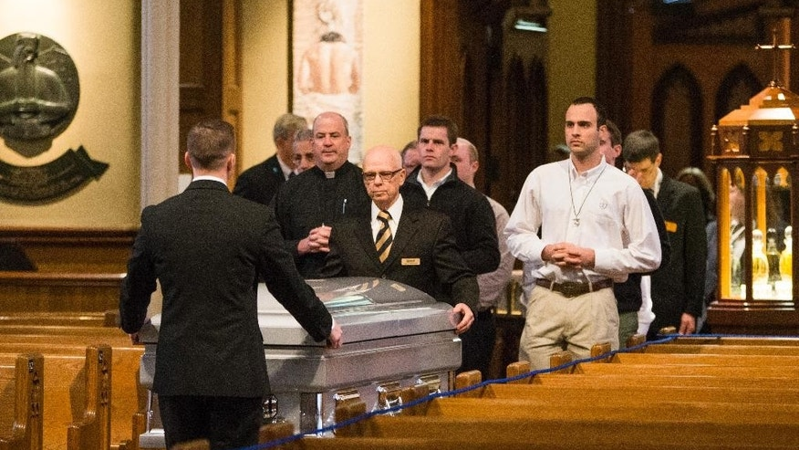 The body of Rev. Theodore Hesburgh is brought in to the Sacred Heart Basilica at the University of Notre Dame in for visitation on Tuesday, March 3, 2015, in South Bend, Ind. Thousands of students, alumni and admirers are expected on the University of Notre Dame campus Tuesday to pay their respects to the Rev. Theodore Hesburgh, who served as the school's president for 35 years while also promoting human rights. Hesburgh died Thursday, Feb. 26, 2015. He was at 97. (AP Photo/South Bend Tribune, Robert Franklin, Pool)