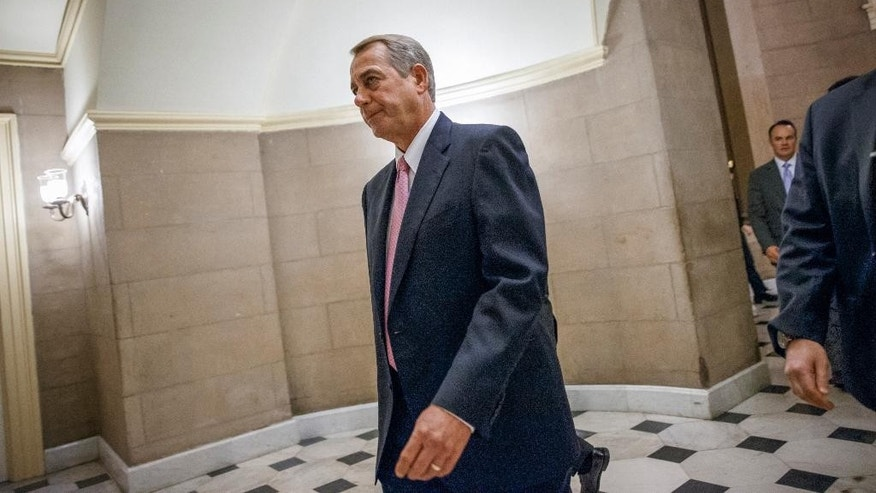 House Speaker John Boehner of Ohio walks to the House chamber on Capitol Hill in Washington, Tuesday, March 3, 2015. Boehner's job is safe despite passing yet another big bill that most of his Republican colleagues oppose, as he did Tuesday to avert defunding the Department of Homeland Security. But Boehner and his leadership team appear destined to confront fratricidal fights for months to come. The friction exposes deep GOP ideological differences as the 2016 presidential campaign gets under way.  (AP Photo/J. Scott Applewhite)