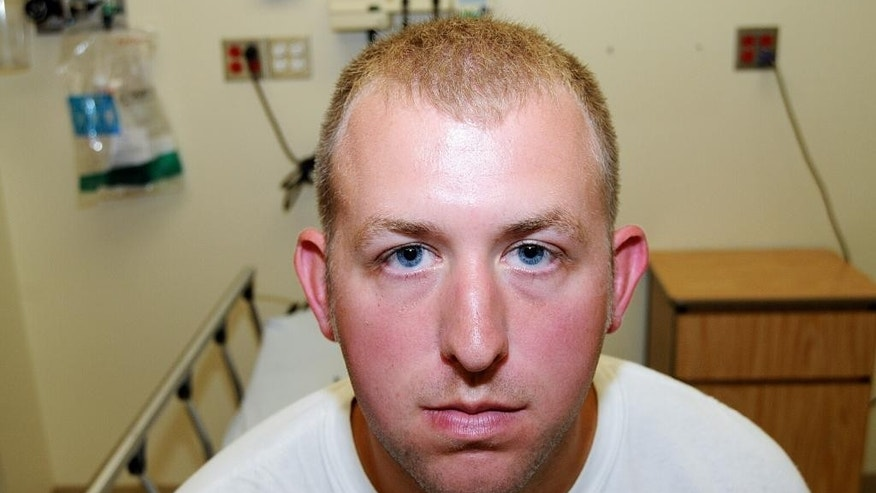 FILE - This 2014 file photo provided by the St. Louis County Prosecuting Attorney's office is Ferguson police officer Darren Wilson during his medical examination after he fatally shot Michael Brown, in Ferguson, Mo.  (AP Photo/St. Louis County Prosecuting Attorney's Office, File)
