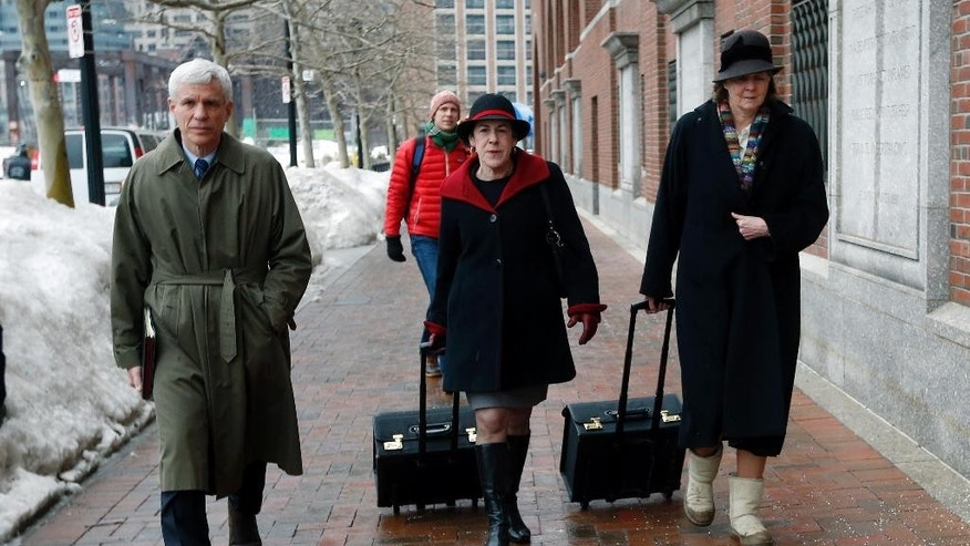 Members of the legal defense team for Boston Marathon bombing suspect Dzhokhar Tsarnaev, including David Bruck, left, Miriam Conrad, center, and Judy Clarke, right, arrive at federal court, Wednesday, March 4, 2015, in Boston, on the first day of Tsarnaev's federal death penalty trial. Tsarnaev is charged with conspiring with his brother to place two bombs near the marathon finish line in April 2013, killing three and injuring 260 people. (AP Photo/Michael Dwyer)